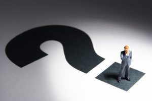 business figures and question mark